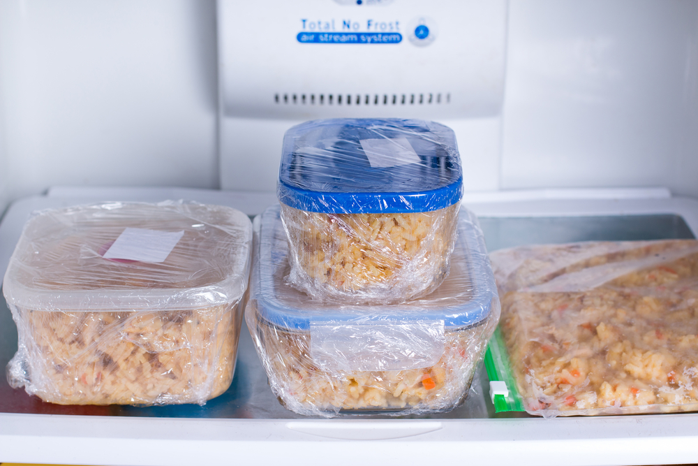 Meal prep in containers in the refrigerator ready to be frozen for later use.