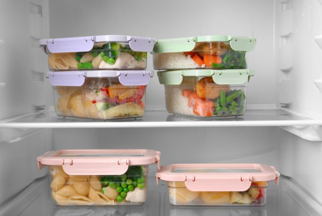 Boxes with prepared meals inside of refrigerator