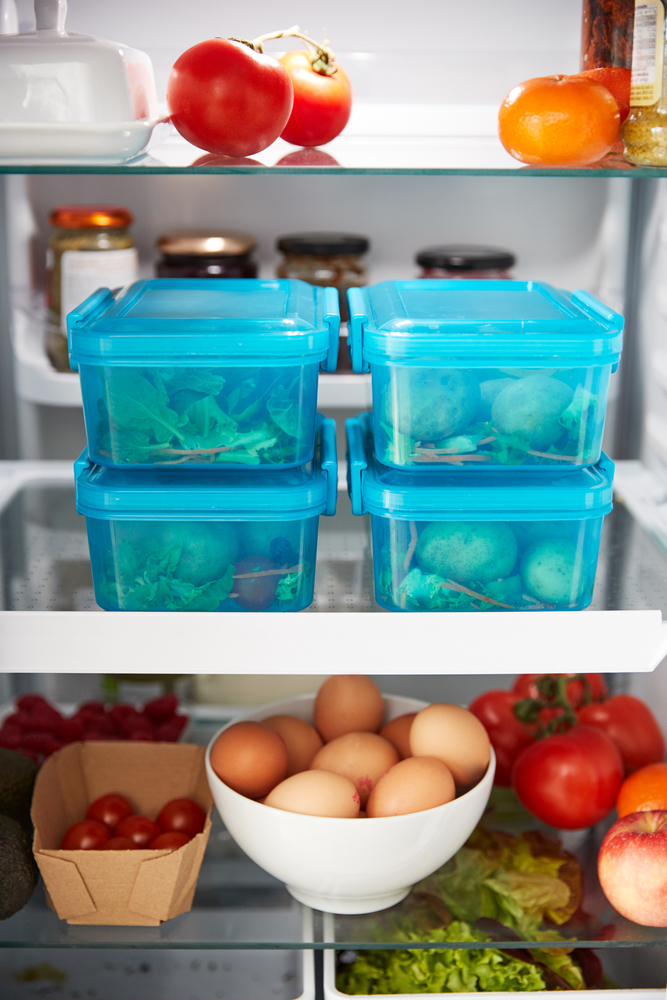 View Inside Refrigerator Of Healthy Food And Packed Lunches In Plastic Containers